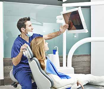 Image of a dentist educate his patient about teeth replaced after extraction